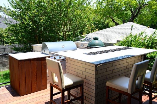 Custom outdoor kitchen on patio deck